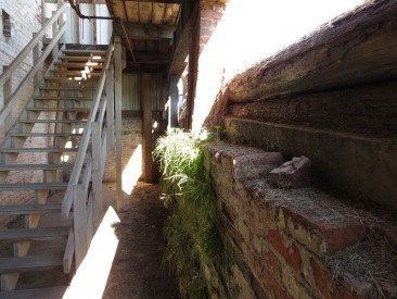 Stairway leading to the bottom level of the Palmetto Compress & Warehouse Co.