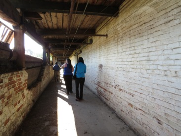 Faith Creech (left) and Ebony Wilson (right) explore the Palmetto Compress Warehouse Co.